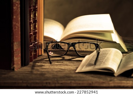 reading glasses with books on the table #227852941