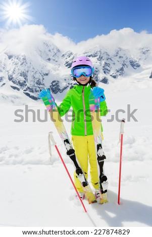 Ski, winter fun - lovely skier girl enjoying ski vacation  #227874829