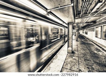 New York City subway train speeding up. #227982916