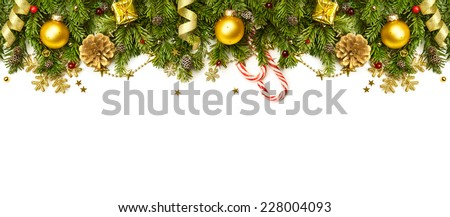 Christmas Border - tree branches with golden baubles, stars, snowflakes isolated on white,  horizontal banner Royalty-Free Stock Photo #228004093