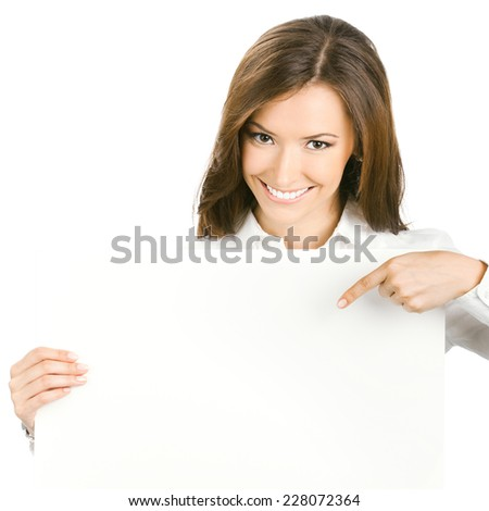 Happy smiling beautiful young business woman showing blank signboard, isolated over white background #228072364