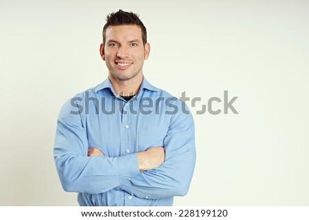Portrait of handsome smiling man in blue shirt #228199120