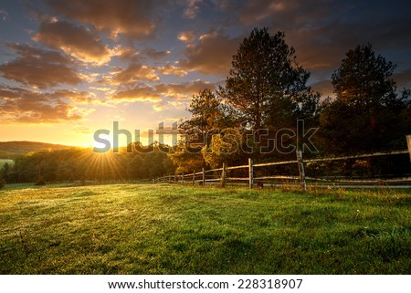 Picturesque landscape, fenced ranch at sunrise Royalty-Free Stock Photo #228318907