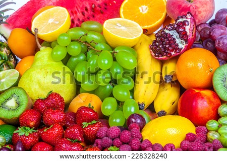 Huge group of fresh fruits isolated on a white background. Shot in a studio #228328240
