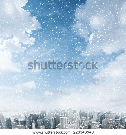 Snow falling down over the city