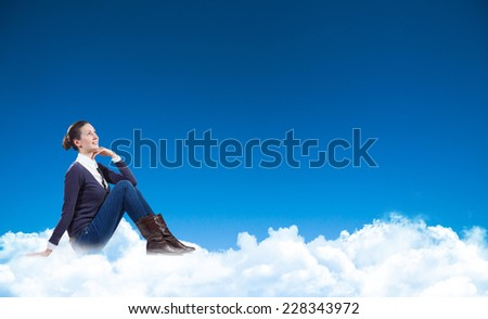 business woman sitting on the clouds and looking up #228343972