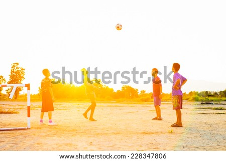 Group of the kids (boys) are playing football for exercise in the sunshine day. #228347806