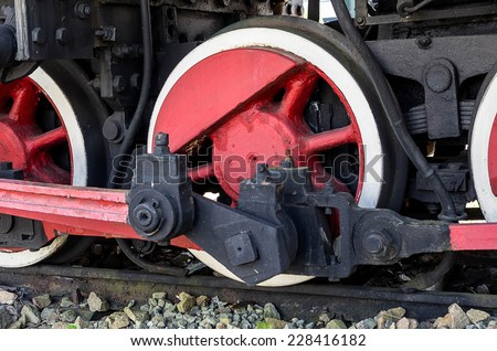 The drive wheels of an old steam locomotive #228416182
