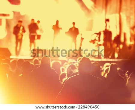 music concert in the street at night blurred background
