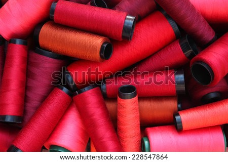colorful threads in red tone #228547864