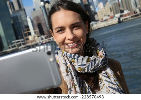 Brunette girl making selfy with Manhattan in background #228570493