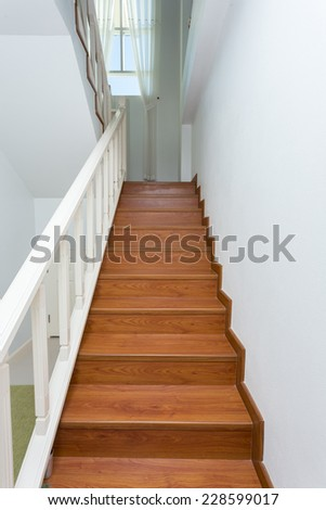 wooden staircase made from laminate wood in white modern house #228599017