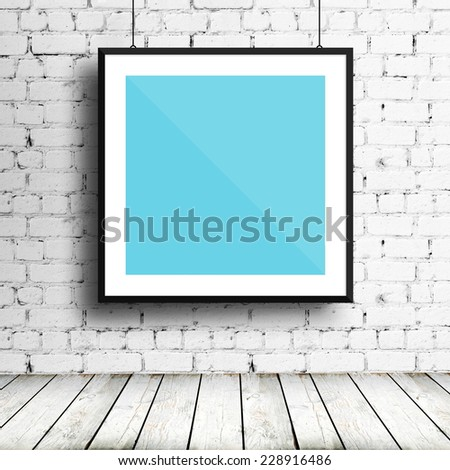 Poster mockup template with black frame on brick wall #228916486