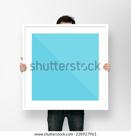 man holding frame on white background #228927961