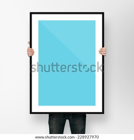 man holding poster mockup template with frame on white backgrou #228927970