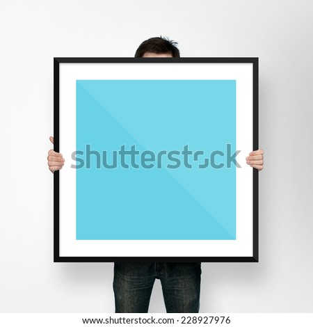 man holding poster mockup template with frame on white backgroun #228927976