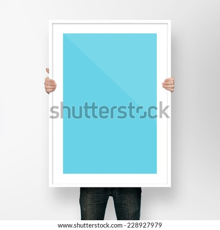 man holding poster mockup template with frame on white backgroun #228927979