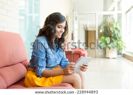 Fashion woman using tablet with background light  #228944893