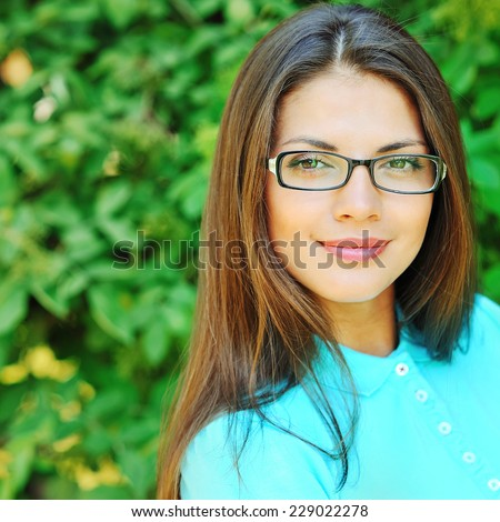 Beautiful girl in glasses - close up  #229022278