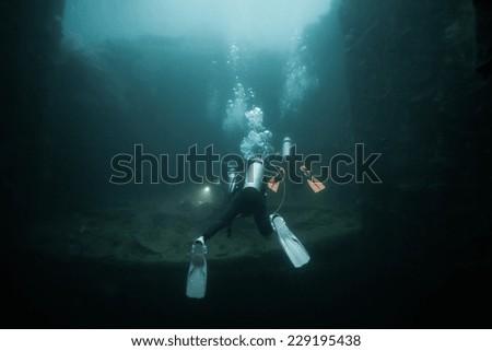Scuba diver exploring world war II shipwreck in Coron area, Palawan, Philippines. #229195438
