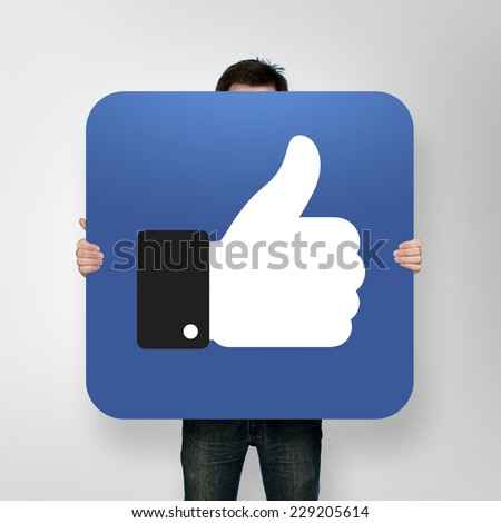 man holding poster with like icon #229205614