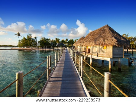 The wooden road over the sea to the tropical island.  #229258573