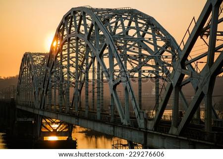 sunset over railway bridge across Dnepr river. Kiev, Ukraine #229276606