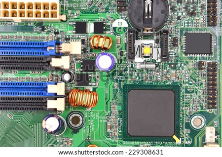 Printed computer motherboard with microcircuit, close up #229308631