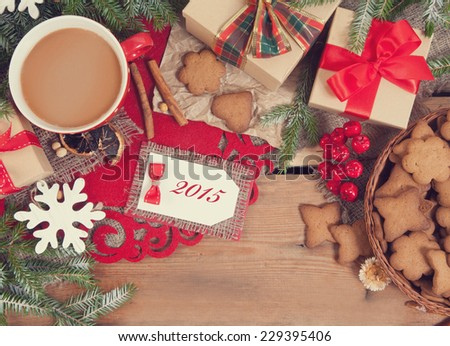 Gingerbread cookies and cup of coffee with christmas decoration #229395406