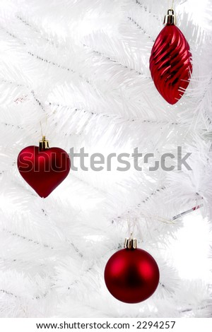 Christmas ornaments hanging from a white tree #2294257