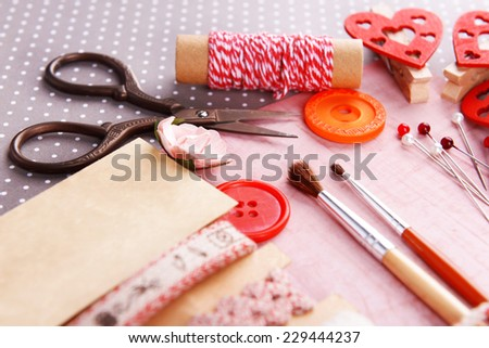 Scrapbooking craft materials on bright background Royalty-Free Stock Photo #229444237