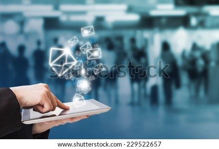 Businesswoman checking email by using digital tablet #229522657