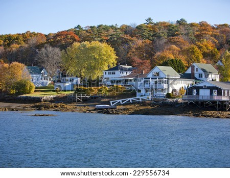 Beautiful New England colonial style homes on the water in fall #229556734