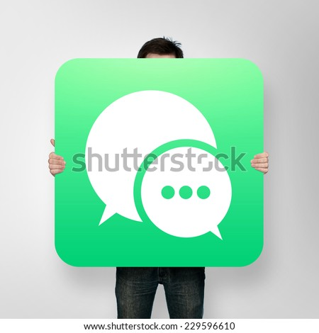 man holding poster with chat icon Royalty-Free Stock Photo #229596610