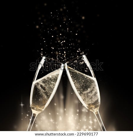 Two glasses of champagne with splash, on black background #229690177