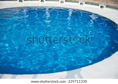 Background of rippled pattern of clean water in a blue swimming pool #229711330