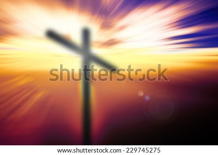 Blurred the cross on the mountain golgotha representing the day of christs crucifixion in a sunset. #229745275