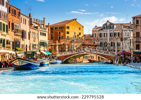 VENICE, ITALY - 26 OCTOBER 2014: Ponte delle Guglie (Bridge of Spires). It is the only bridge in Venice adorned with spires (added 1823) from whence it takes its name. Venice, Italy, October 26, 2014 #229795528