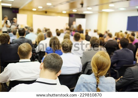 The audience listens to the acting in a conference hall #229810870