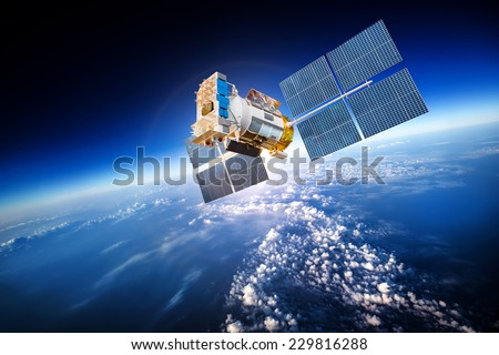 Space satellite orbiting the earth. Elements of this image furnished by NASA Royalty-Free Stock Photo #229816288