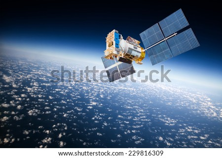 Space satellite orbiting the earth. Elements of this image furnished by NASA Royalty-Free Stock Photo #229816309
