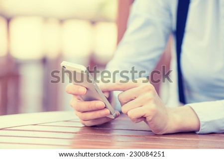 Closeup image woman hands holding, using smart, mobile phone isolated outside city background. New generation technology, people phone addiction concept. Customer, service provider relationship