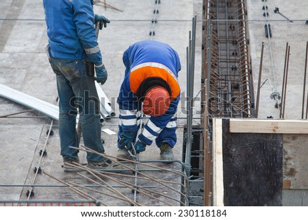Construction worker connects fittings wire #230118184