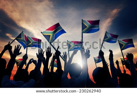 Group of People Waving South African Flags in Back Lit Royalty-Free Stock Photo #230262940