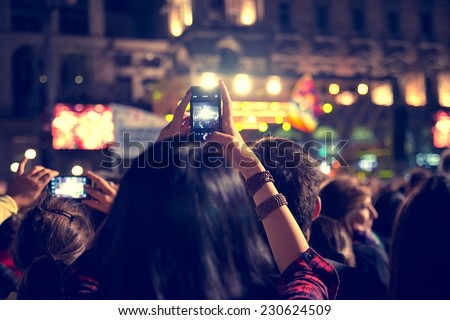 Supporters recording at concert - Candid image of crowd at rock concert Royalty-Free Stock Photo #230624509