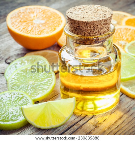 Citrus essential oil and slice of ripe fruits: orange, lemon and lime fruits #230635888