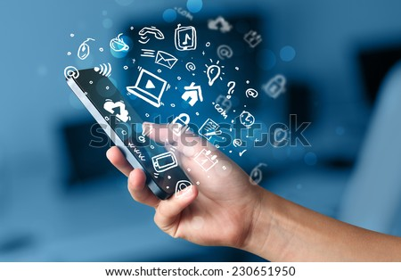 Hand holding smartphone with media icons and symbol collection #230651950