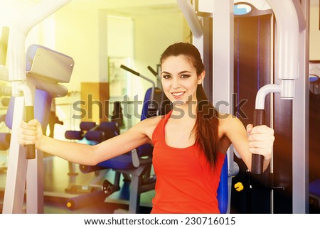 Beautiful woman training with weights in gym #230716015