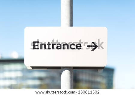 Entrance sign with direction arrow