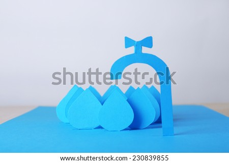 Concept of water conservation cut paper